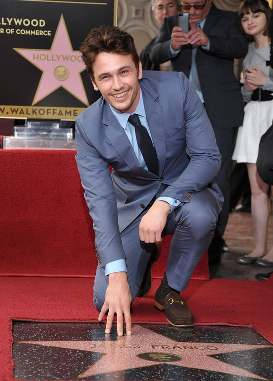 Description of . Actor James Franco poses with his star at a ceremony honoring him on the Hollywood Walk of Fame on Thursday, March 7, 2013 in Los Angeles. (Photo by John Shearer/Invision/AP)