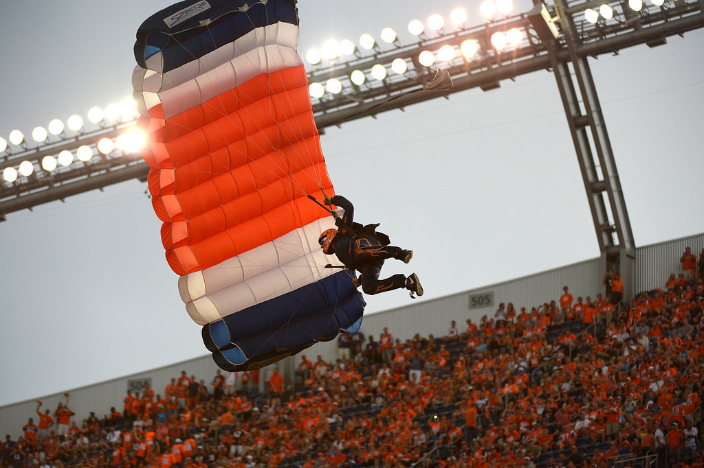 Description of . Parachutists enter the stadium and land on the field before the game begins.  (Photo by Joe Amon/The Denver Post)
