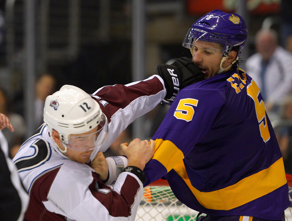 Description of . Colorado Avalanche right wing Chuck Kobasew, left, fights Los Angeles Kings defenseman Keaton Ellerby during the third period of their NHL hockey game, Saturday, Feb. 23, 2013, in Los Angeles. The Kings won 4-1.  (AP Photo/Mark J. Terrill)