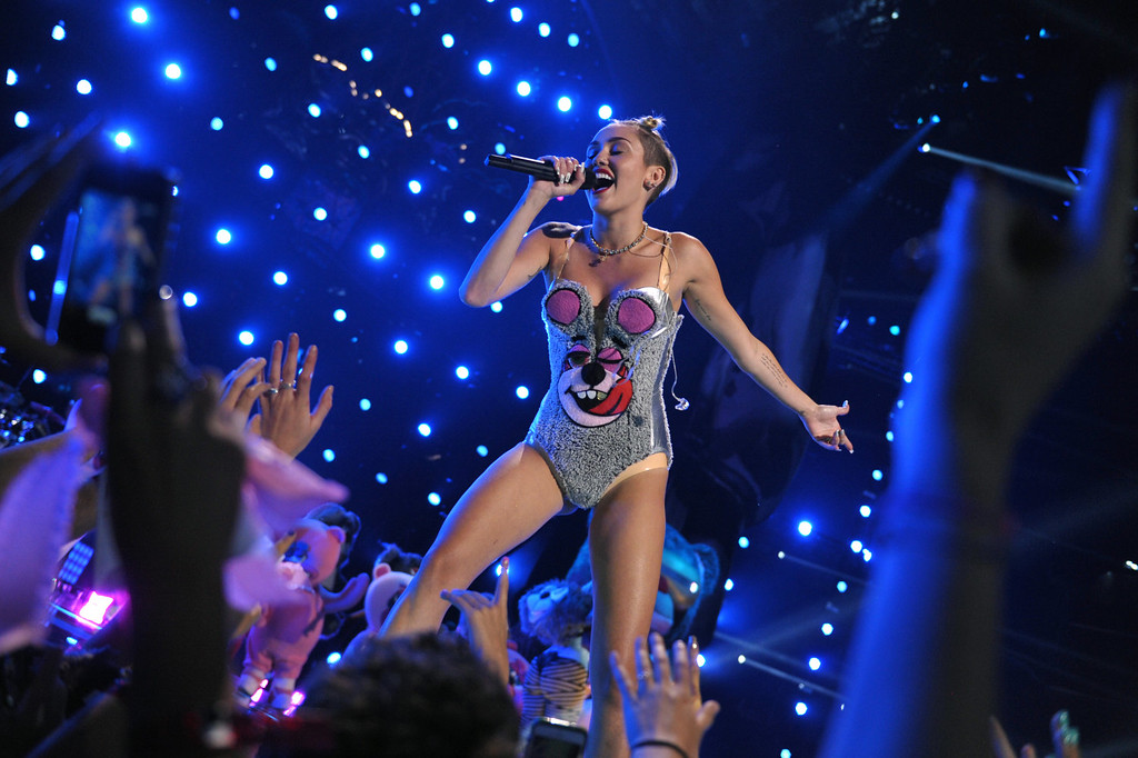 Description of . Miley Cyrus performing at the MTV Video Music Awards at Barclays Center on Sunday, Aug. 25, 2013, in the Brooklyn borough of New York. (AP Photo/MTV, John Shearer)