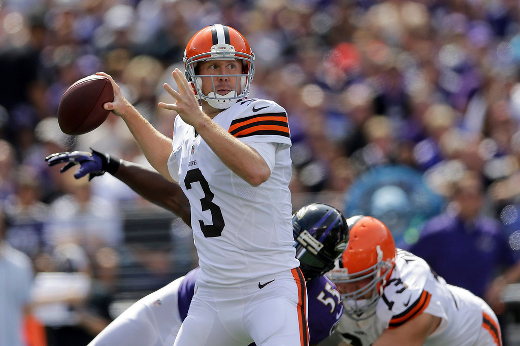 Description of . Cleveland Browns quarterback Brandon Weeden looks for an open man during the first half of an NFL football game against the Baltimore Ravens in Baltimore, Md., Sunday Sept. 15, 2013. (AP Photo/Patrick Semansky)