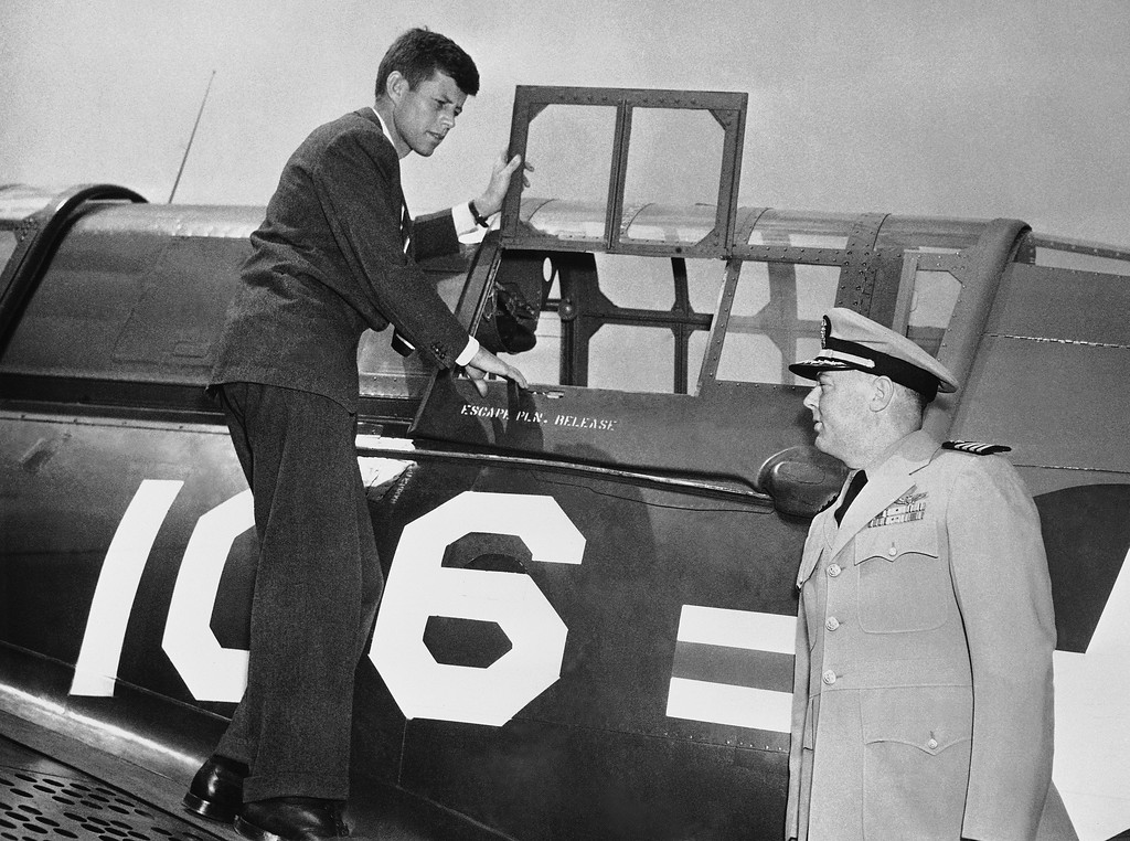 Description of . Rep. John F. Kennedy, D-Mass, a PT boat skipper in World War II, inspects a plane of the Naval Air Reserve group at Anacostia Naval Air Station on June 26, 1947, in Washington.  With him is U.S. Navy Capt. Frederick Funke, commanding officer of the Naval Air Reserve training unit, which was observing its first birthday. Associated Press file