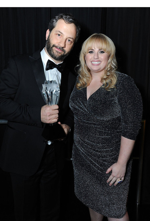 Description of . Judd Apatow toasts his Critics Choice LOUIS XIII Genius Award with Rebel Wilson at the Critics' Choice Movie Awards at Barker Hangar on Thursday, January 10, 2013 in Santa Monica, Calif.  (PRNewsFoto/Louis XIII de Remy Martin, Jordan Strauss/Invision)