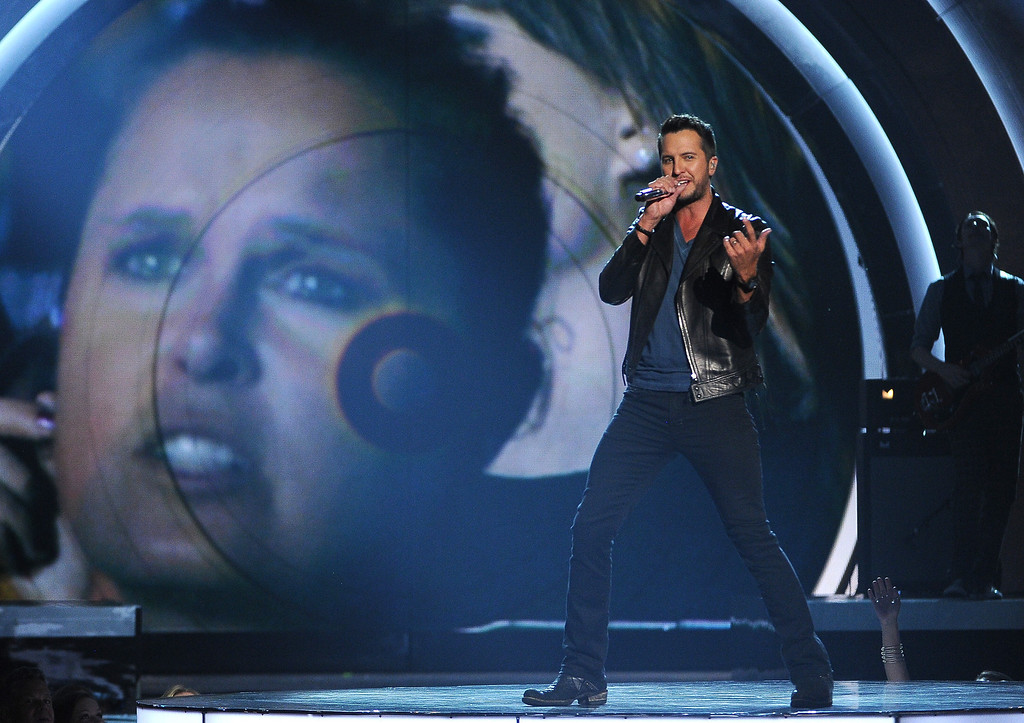 Description of . Luke Bryan performs on stage at the 49th annual Academy of Country Music Awards at the MGM Grand Garden Arena on Sunday, April 6, 2014, in Las Vegas. (Photo by Chris Pizzello/Invision/AP)