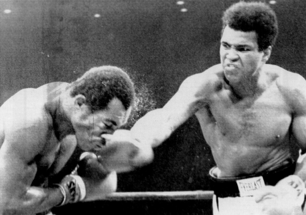 Description of . Muhammad Ali scores with a solid right to the head of ken Norton as he goes on to win a split decision. Ali was defeated 5½ months ago by Norton in San Diego when he broke the jaw of Ali.	1973. Denver Post Library photo archive