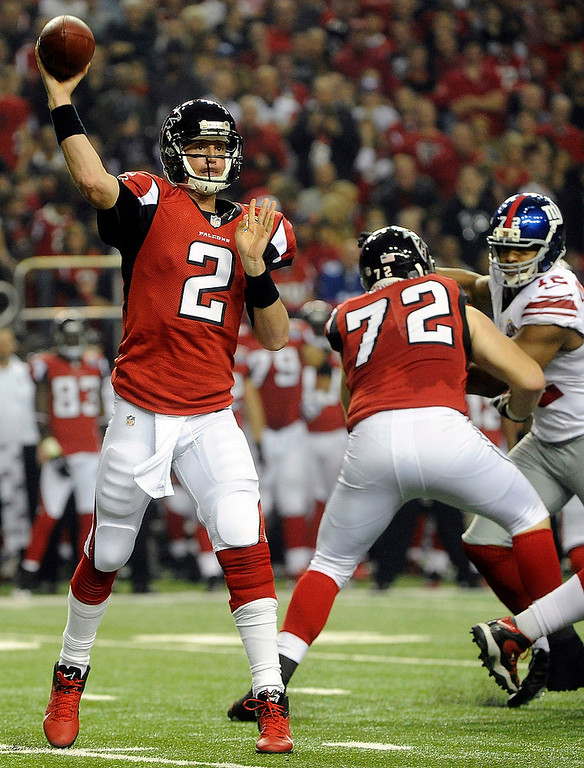 Description of . Atlanta Falcons quarterback Matt Ryan (2) works against the New York Giants during the first half of an NFL football game on Sunday, Dec. 16, 2012, in Atlanta. (AP Photo/John Amis)