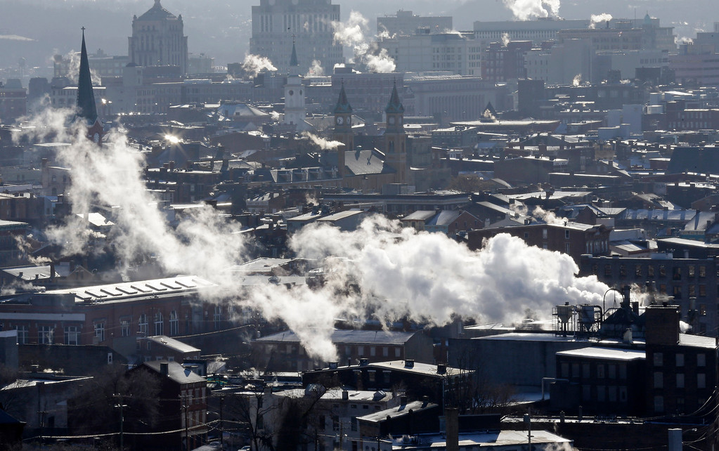 Description of . Steam rises from buildings Tuesday, Jan. 7, 2014, in downtown Cincinnati where temperatures were below zero in the morning.  Brutal, life-threatening cold descended over the East and the South, sending the mercury plummeting Tuesday into the single digits and teens. (AP Photo/Al Behrman)