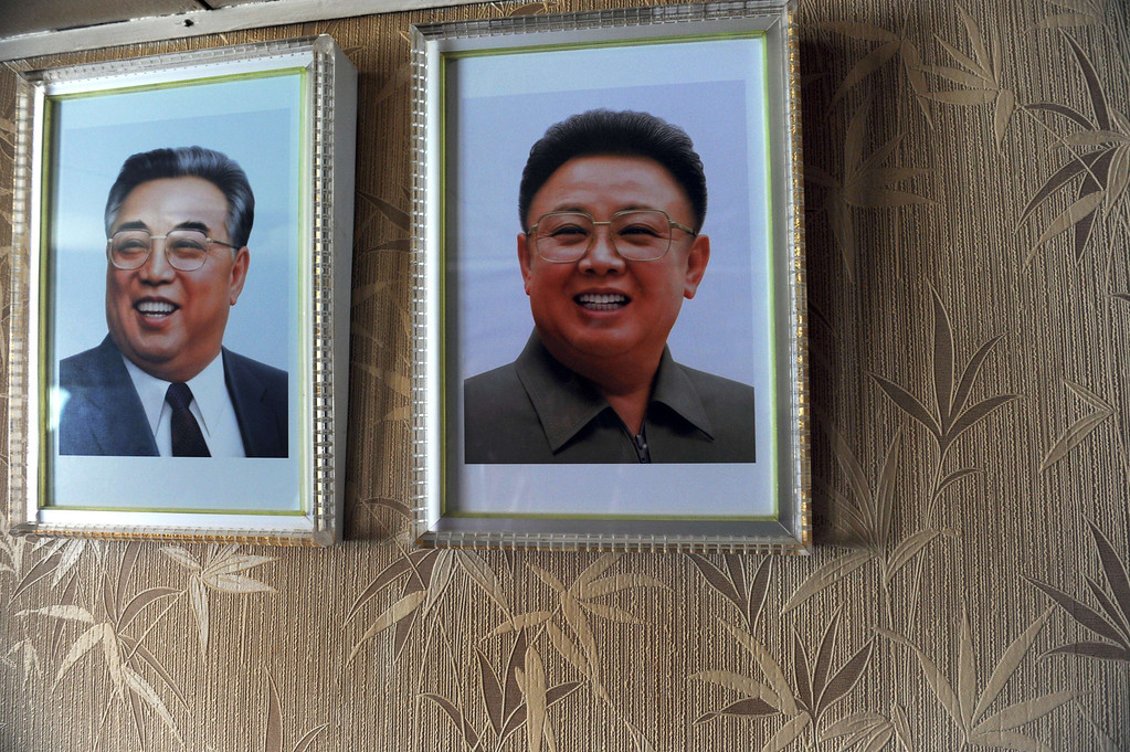 Description of . Portraits of late North Korean leaders Kim il-Sung(L)  and Kim Jong-il are seen inside of North Korean vessel Chong Chong Gang at  Manzanillo harbour in Colon, 90km from Panama City on July 16, 2013.  AFP PHOTO / Rodrigo  ARANGUA/AFP/Getty Images