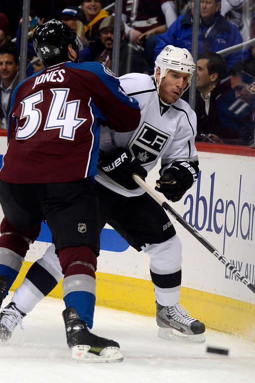Description of . DENVER, CO. - JANUARY 22: Colorado Avalanche right wing David Jones (54) gets physical with Los Angeles Kings defenseman Rob Scuderi (7) during the first period. The Colorado Avalanche hosted the Los Angeles Kings at the Pepsi Center on January, 22, 2013.   (Photo By John Leyba / The Denver Post)