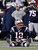 New England Patriots quarterback Tom Brady sits on the turf in front of head coach Bill Belichick after an incomplete pass on a fourth down try in the fourth quarter against the Baltimore Ravens in the NFL AFC Championship football game in Foxborough, Massachusetts, January 20, 2013.  REUTERS/Jim Young