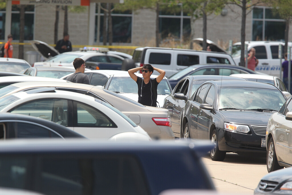 Description of . Students wait to leave Lone Star College's Cy-Fair campus in Cypress, Texas, where a student went on a building-to-building stabbing attack Tuesday, April 9, 2013. (AP Photo/Houston Chronicle, Mayra Beltran)
