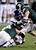 TCU running back B.J. Catalon, center, is tackled between Michigan State defensive end Marcus Rush, left, and linebacker Max Bullough, right, during the first half of the Buffalo Wild Wings Bowl NCAA college football game, Saturday, Dec. 29, 2012, in Tempe, Ariz. (AP Photo/Paul Connors)