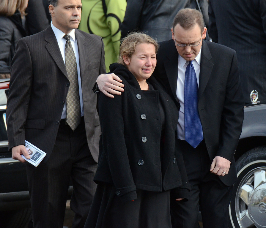 Description of . Staff photos by Tom Kelly IV Mourners are overcome with emotions as they leave the funeral service of Jessica Rekos.  Funerals for two, six year old students from the Sandy Hook Elementary School in Newtown, CT took part Tuesday December 18, 2012.  Mourners paid their respects at the Saint Rose of Lima Church.