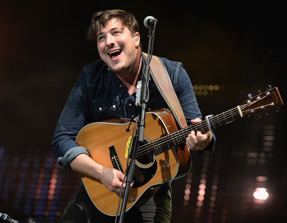 Description of . CHICAGO, IL - AUGUST 03:  Marcus Mumford of Mumford & Sons performs during Lollapalooza 2013 at Grant Park on August 3, 2013 in Chicago, Illinois.  (Photo by Theo Wargo/Getty Images)