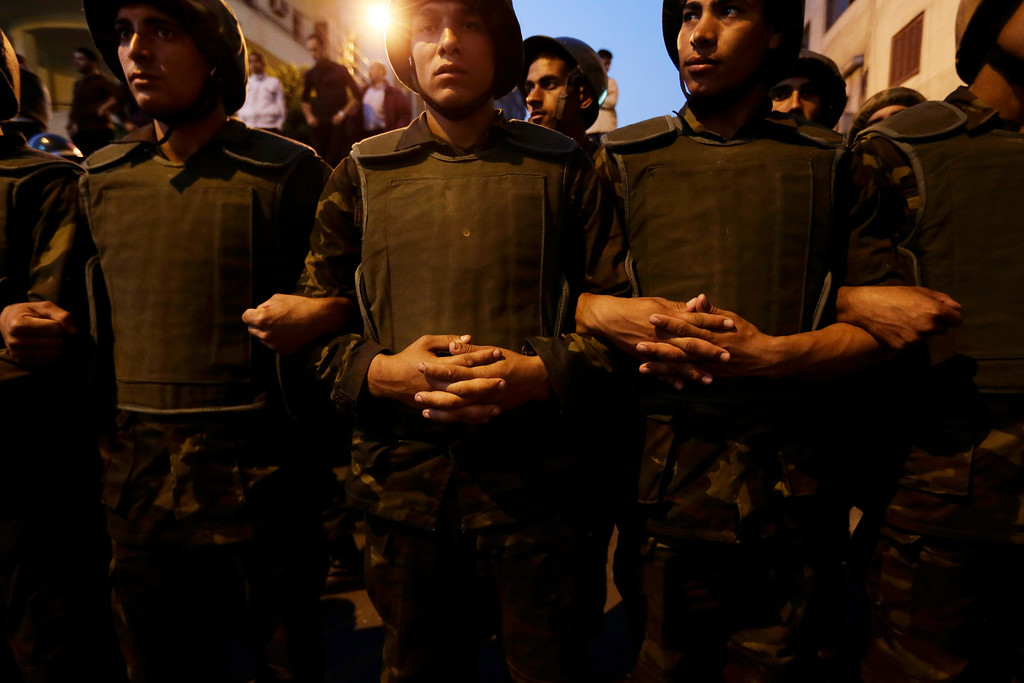 Description of . Egyptian army soldiers stand guard near the presidential palace in Cairo, Egypt, Sunday, Dec. 9, 2012. Egypt\'s liberal opposition called for more protests Sunday, seeking to keep up the momentum of its street campaign after the president made a partial concession overnight but refused its main demand he rescind a draft constitution going to a referendum on Dec. 15. (AP Photo/Hassan Ammar)