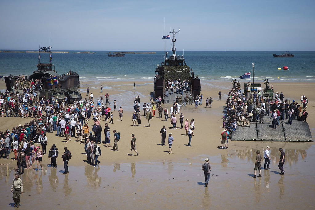 Description of . People visit World War II landing crafts on the Arromanches beach, Normandy, on June 6, 2014 during the ceremonies marking the 70th anniversary of the Operation Overlord.   AFP PHOTO / JOEL SAGETJOEL SAGET/AFP/Getty Images