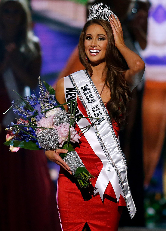 Description of . Miss Nevada USA Nia Sanchez is crowned Miss USA during the Miss USA 2014 pageant in Baton Rouge, La., Sunday, June 8, 2014. (AP Photo/Jonathan Bachman)