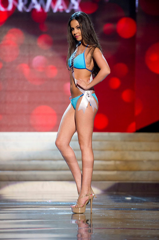 Description of . Miss Norway Sara Nicole Andersen competes in her Kooey Australia swimwear and Chinese Laundry shoes during the Swimsuit Competition of the 2012 Miss Universe Presentation Show at PH Live in Las Vegas, Nevada December 13, 2012. The 89 Miss Universe Contestants will compete for the Diamond Nexus Crown on December 19, 2012. REUTERS/Darren Decker/Miss Universe Organization/Handout