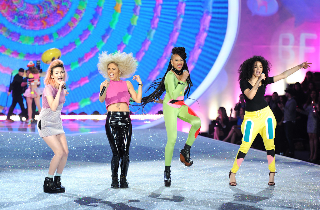 Description of . British girl group Neon Jungle, from left, Asami Zdrenka, Jess Plummer, Amira McCarthy and Shereen Cutkelvin perform during the 2013 Victoria's Secret Fashion Show at the 69th Regiment Armory on Wednesday, Nov. 13, 2013, in New York. (Photo by Evan Agostini/Invision/AP)