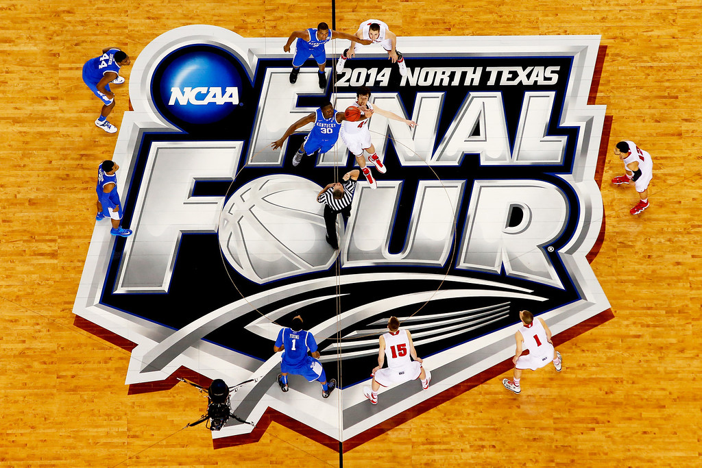 Description of . ARLINGTON, TX - APRIL 05:  Frank Kaminsky #44 of the Wisconsin Badgers and Julius Randle #30 of the Kentucky Wildcats jump for the opening tip during the NCAA Men's Final Four Semifinal at AT&T Stadium on April 5, 2014 in Arlington, Texas.  (Photo by Tom Pennington/Getty Images)