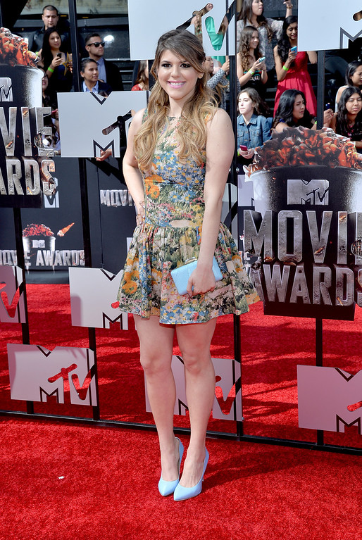 Description of . Actress Molly Tarlov attends the 2014 MTV Movie Awards at Nokia Theatre L.A. Live on April 13, 2014 in Los Angeles, California.  (Photo by Michael Buckner/Getty Images)