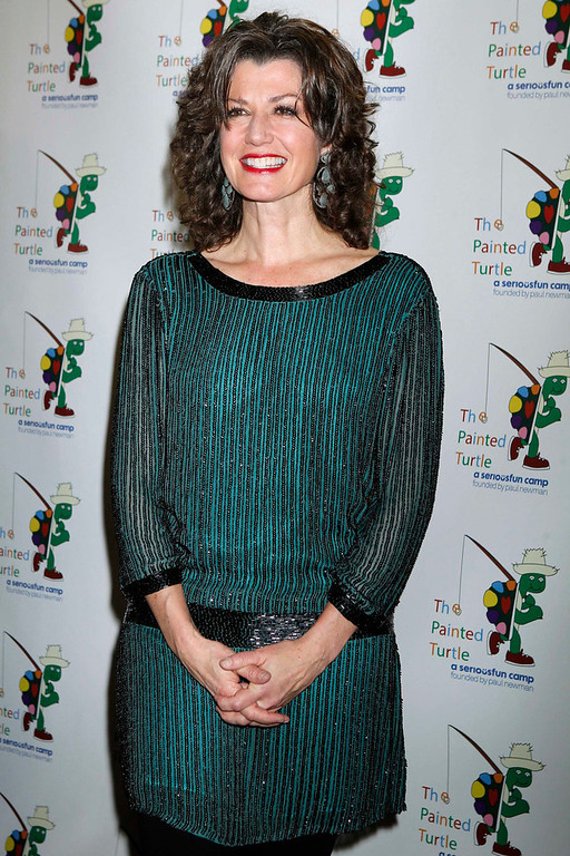 Description of . Singer and songwriter Amy Grant poses on the arrivals line at