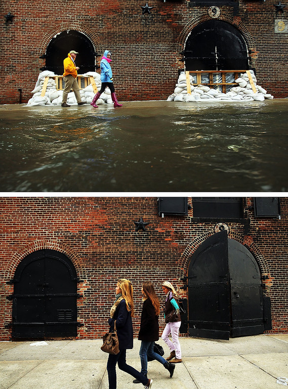 Description of . NEW YORK, NY - OCTOBER 29:  (top)  People walk past sandbags on a flooded street as Hurricane Sandy moves closer to the area on October 29, 2012 in the Red Hook section of the Brooklyn borough of New York City. YORK, NY - OCTOBER 23:  (bottom) People walk past a building on October 23, 2013 in the Red Hook section of the Brooklyn borough of New York City. Hurricane Sandy made landfall on October 29, 2012 near Brigantine, New Jersey and affected 24 states from Florida to Maine and cost the country an estimated $65 billion. (Photos by Spencer Platt/Getty Images)