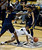 Colorado Buffaloes guard Brittany Wilson (11) falls to the court as California Golden Bears guard Afure Jemerigbe (2) and California Golden Bears guard Brittany Boyd (15) double team her during the second half Sunday, January 6, 2013 at Coors Events Center. John Leyba, The Denver Post