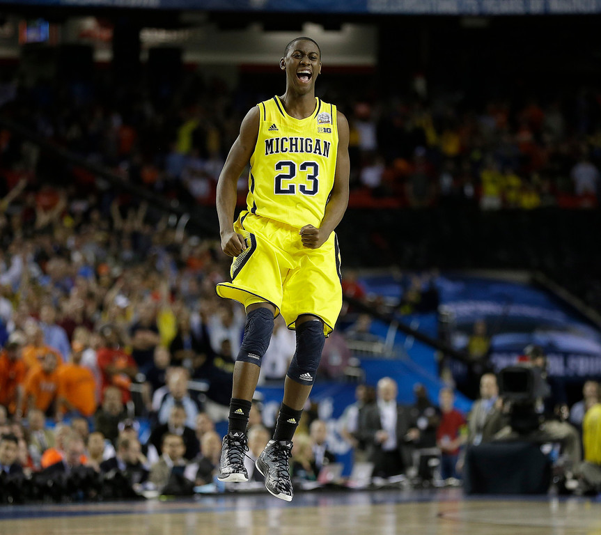 Description of . Michigan's Caris LeVert (23) reacts during the second half of the NCAA Final Four tournament college basketball semifinal game against Syracuse, Saturday, April 6, 2013, in Atlanta. Michigan won 61-56. (AP Photo/Charlie Neibergall)