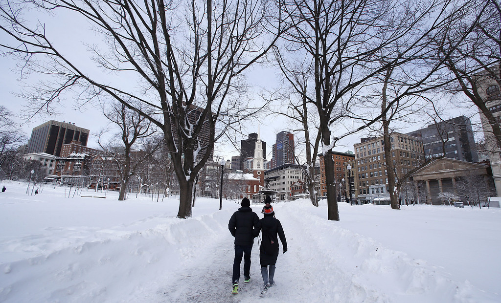 . A couple walks through Boston Common in Boston, Saturday, Feb. 9, 2013.  The Boston area received about two feet of snow from a winter storm. A howling storm across the Northeast left the New York-to-Boston corridor shrouded in 1 to 3 feet of snow Saturday, stranding motorists on highways overnight and piling up drifts so high that some homeowners couldn\'t get their doors open. More than 650,000 homes and businesses were left without electricity. (AP Photo/Charles Krupa)