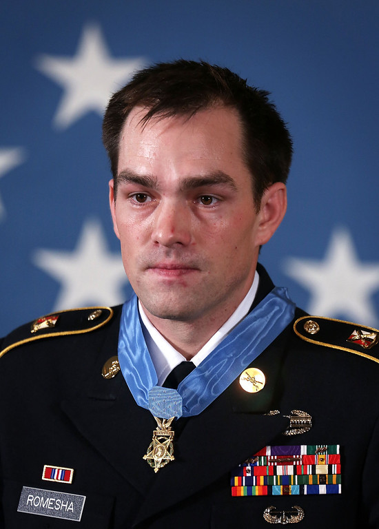 Description of . Clinton Romesha, a former active duty Army Staff Sergeant, stands after he was presented with the Medal of Honor for conspicuous gallantry by U.S. President Barack Obama at the White House February 11, 2013 in Washington, DC. (Photo by Alex Wong/Getty Images)