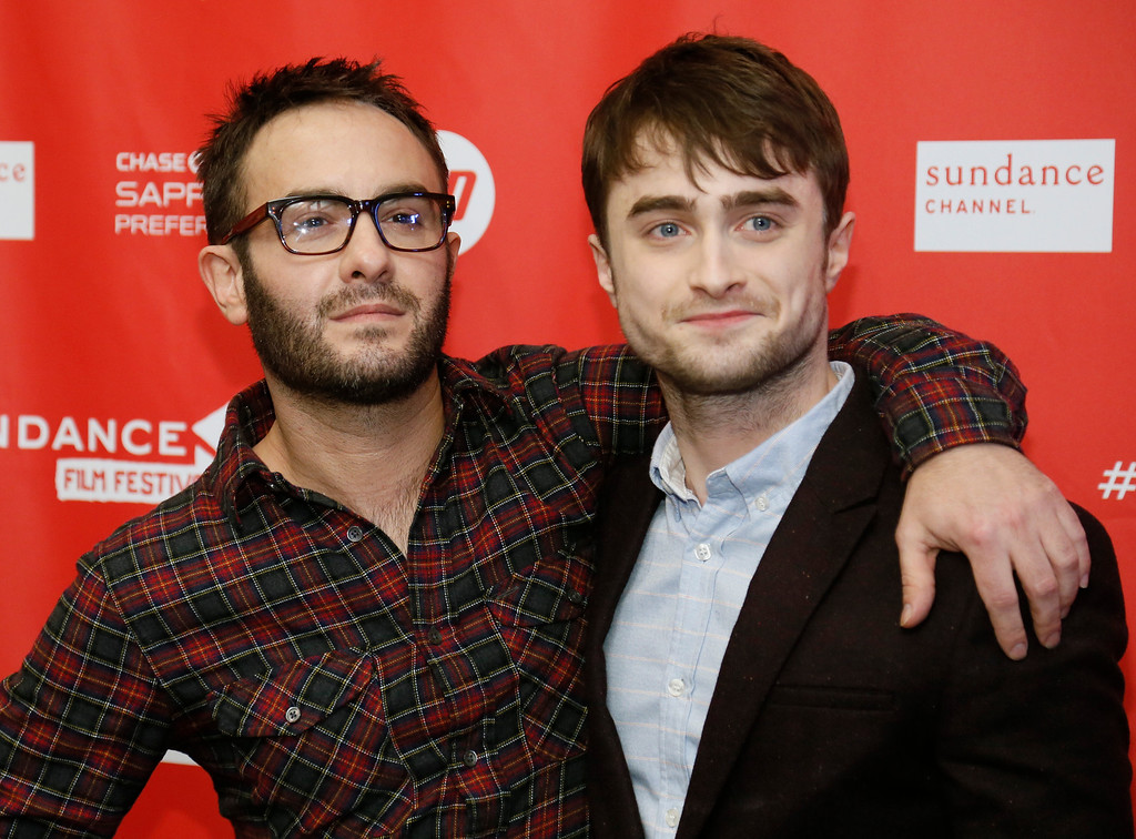 Description of . Director John Krokidas, left, and actor Daniel Radcliffe pose at the premiere of