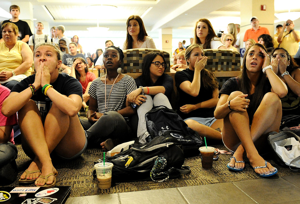 Description of . Penn State students and others react to the sanctions the NCAA announced against Penn State in the HUB on the campus of Penn State on July 23, 2012 in State College, Pennsylvania. As an outcome of the university's mishandling of the allegations of child-sexual abuse by former coach Jerry Sandusky, Penn State was fined $60 million, was stripped of all its football wins from 1998 through 2011, barred from postseason games for four years, and lost 20 total scholarships annually for four seasons.  (Photo by Patrick Smith/Getty Images)
