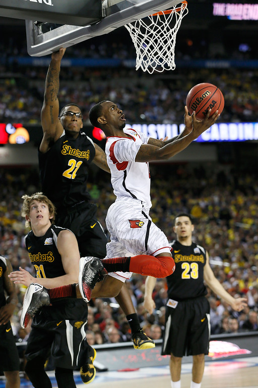 Description of . ATLANTA, GA - APRIL 06:  Russ Smith #2 of the Louisville Cardinals drives for a shot attempt in the second half against the Wichita State Shockers during the 2013 NCAA Men's Final Four Semifinal at the Georgia Dome on April 6, 2013 in Atlanta, Georgia.  (Photo by Kevin C. Cox/Getty Images)
