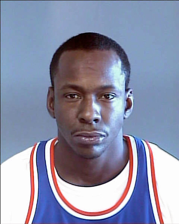 Description of . Singer Bobby Brown, shown in a photo released by the DeKalb County (Ga.) Sheriff's office Thursday, Nov. 7, 2002,  was arrested early Thursday in Atlanta's trendy Buckhead district on drug and traffic charges. An officer at the Atlanta city jail said Brown was charged with possession of less than an ounce of marijuana, speeding and having no driver's license or proof of insurance.  Brown posted $1,500 bond at the Atlanta jail shortly before 9 a.m. He was then taken to the nearby DeKalb County jail, where he was wanted for failing to appear in court on driving charges from February 1997. (AP Photo/HO, DeKalb County Sheriff)