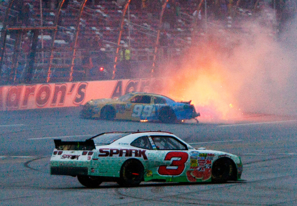 Description of . Austin Dillon (3) spins as Alex Bowman (99) catches fire in a last-lap wreck during the NASACR Nationwide Series auto race at Talladega Superspeedway in Talladega, Ala., Saturday, May 4, 2013. (AP Photo/Ron Sanders)