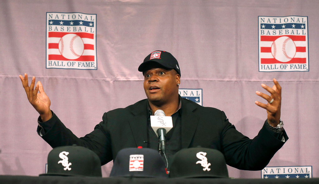 Description of . Chicago White Sox slugger Frank Thomas gestures  during a news conference about his selection into the MLB Baseball Hall Of Fame Wednesday, Jan. 8, 2014, at U.S. Cellular Field in Chicago. Thomas joins Greg Maddux and Tom Glavine as first ballot inductees Wednesday, and will be inducted in Cooperstown on July 27 along with managers Bobby Cox, Joe Torre and Tony La Russa, elected last month by the expansion-era committee. (AP Photo/Charles Rex Arbogast)