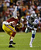 Santana Moss #89 of the Washington Redskins is tackled  by Mike Jenkins #21 of the Dallas Cowboys after catching a pass in the first quarter at FedExField on December 30, 2012 in Landover, Maryland.  (Photo by Rob Carr/Getty Images)