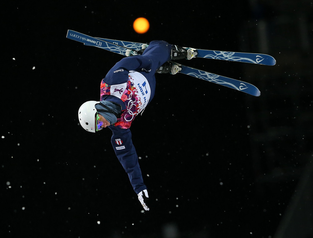 Description of . Mac Bohonnon of the United States jumps during the men's freestyle skiing aerials final at the Rosa Khutor Extreme Park, at the 2014 Winter Olympics, Monday, Feb. 17, 2014, in Krasnaya Polyana, Russia. (AP Photo/Sergei Grits)