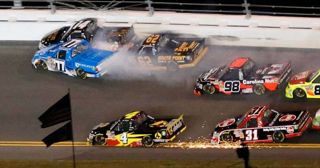 Description of . Trucks crash during the NASCAR Camping World Truck Series NextEra Energy Resources 250 race at the Daytona International Speedway in Daytona Beach, Florida February 22, 2013. In upper left, Brendan Newberry in his number 14 Chevrolet, German Quiroga in his number 77 Toyota and Brendan Gaughan in his number 62 collide, while Jeb Burton in his number 4 Chevrolet and James Bueschek in his number 31 collide. The Daytona 500 NASCAR Sprint Cup race is scheduled for February 24.  REUTERS/Pierre Ducharme