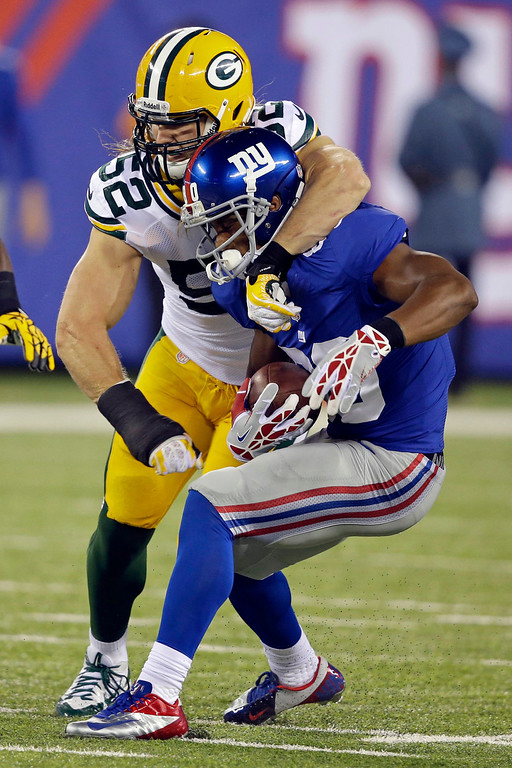 Description of . Green Bay Packers' Clay Matthews (52) attempts to tackle New York Giants' Victor Cruz during the first half of an NFL football game Sunday, Nov. 17, 2013, in East Rutherford, N.J. Cruz breaks the tackle on the play.  AP Photo/Seth Wenig)