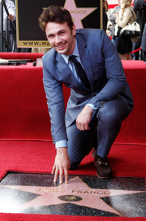 Description of . Actor James Franco poses with his newly unveiled star on the Hollywood Walk of Fame, in Hollywood March 7, 2013. REUTERS/Fred Prouser