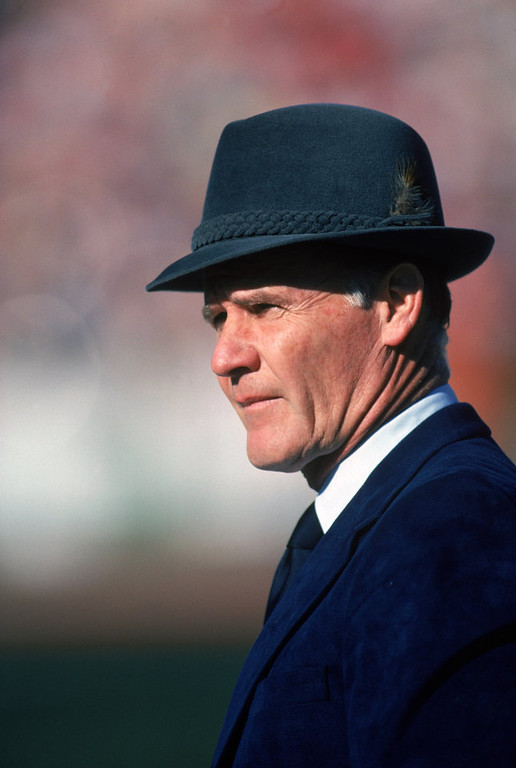 Description of . Head coach Tom Landry of the Dallas Cowboys watches from the sideline during a game against the San Francisco 49ers at Candlestick Park on January 10, 1982 in San Francisco, California. Tom Landry coached the Cowboys from 1960 to 1988, leading them to two Super Bowl victories. (Photo by Getty Images)