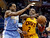 Cleveland Cavaliers' Kyrie Irving (2) drives the lane on Denver Nuggets' Andre Iguodala (9) during the fourth quarter of an NBA basketball game Saturday, Feb. 9, 2013, in Cleveland. The Nuggets won 111-103. (AP Photo/Mark Duncan)