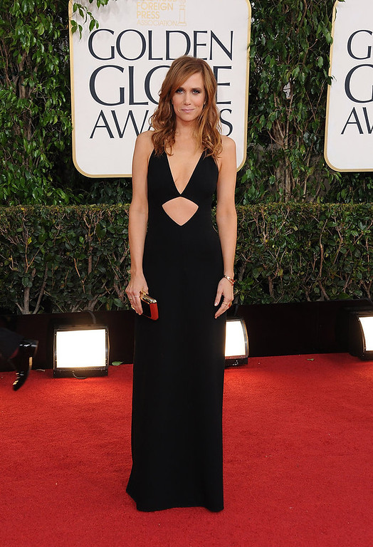 Description of . Actress Kristen Wiig arrives at the 70th Annual Golden Globe Awards at the Beverly Hilton Hotel on Sunday Jan. 13, 2013, in Beverly Hills, Calif. (Photo by Jordan Strauss/Invision/AP)