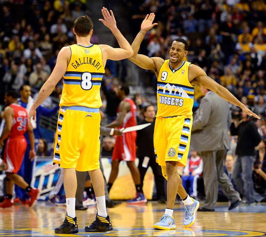 Description of . Denver Nuggets shooting guard Andre Iguodala (9) high fives small forward Danilo Gallinari (8) against the Los Angeles Clippers during the second half of the Nugget's 92-78 win at the Pepsi Center on Tuesday, January 1, 2013. AAron Ontiveroz, The Denver Post