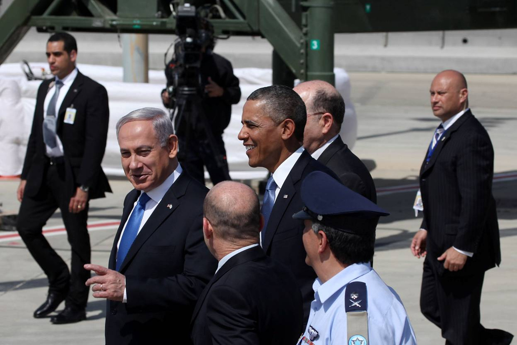 Description of . U.S. President Barack Obama (C) is greeted by Israeli Prime Minister Benjamin Netanyahu (L) during an official welcoming ceremony on his arrival at Ben Gurion International Airport on March, 20, 2013 near Tel Aviv, Israel.  (Photo by Marc Israel Sellem-Pool/Getty Images)