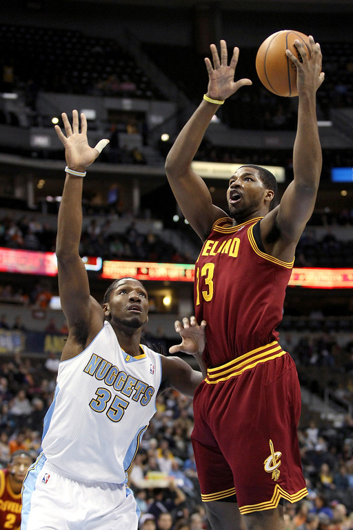 Description of . Tristan Thompson #13 of the Cleveland Cavaliers drives for a shot attempt against Kenneth Faried #35 of the Denver Nuggets at Pepsi Center on January 11, 2013 in Denver, Colorado. (Photo by Chris Chambers/Getty Images)