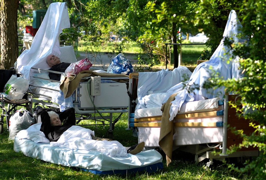 Description of . In this May 29, 2012 file photo, elderly people lay on their beds after they were evacuated from the nearby hospital, in Mirandola, northern Italy. A powerful earthquake killed at least 15 people and left 200 injured as it rocked a swath of northern Italy hit just nine days ago. Factories, warehouses and churches collapsed, dealing a second blow to a region where thousands remained homeless from the previous, stronger temblor. The 5.8 magnitude quake left 14,000 people homeless in the Emilia Romagna region north of Bologna, one of ItalyÌs most agriculturally and industrially productive areas.  (AP Photo/Marco Vasini, File)