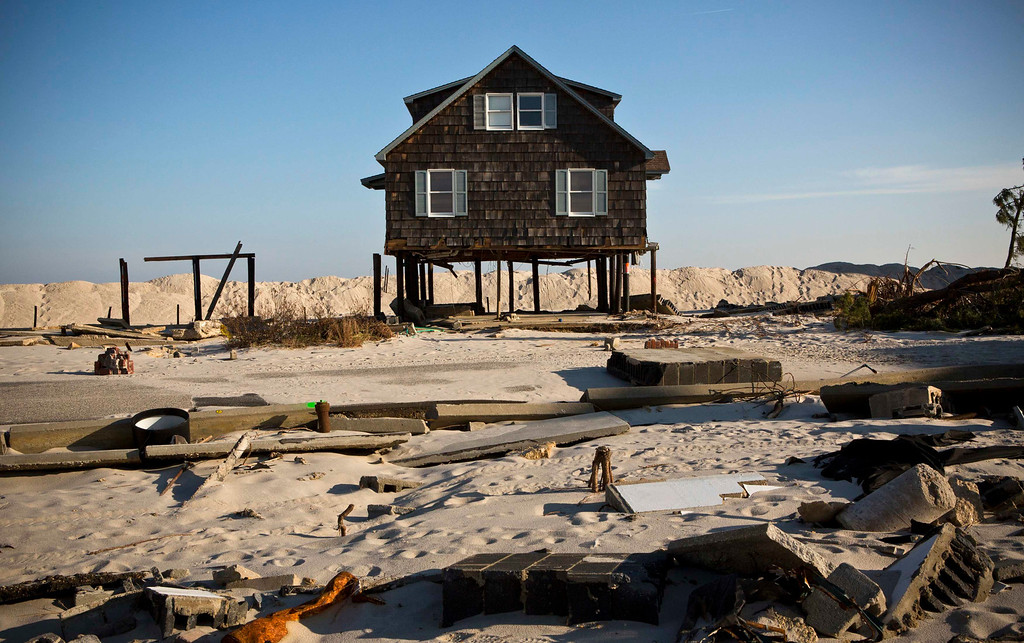 Description of . A home damaged by Hurricane Sandy is seen on the beach front, one month after the storm made landfall, in Mantoloking, New Jersey, November 29, 2012. REUTERS/Andrew Burton